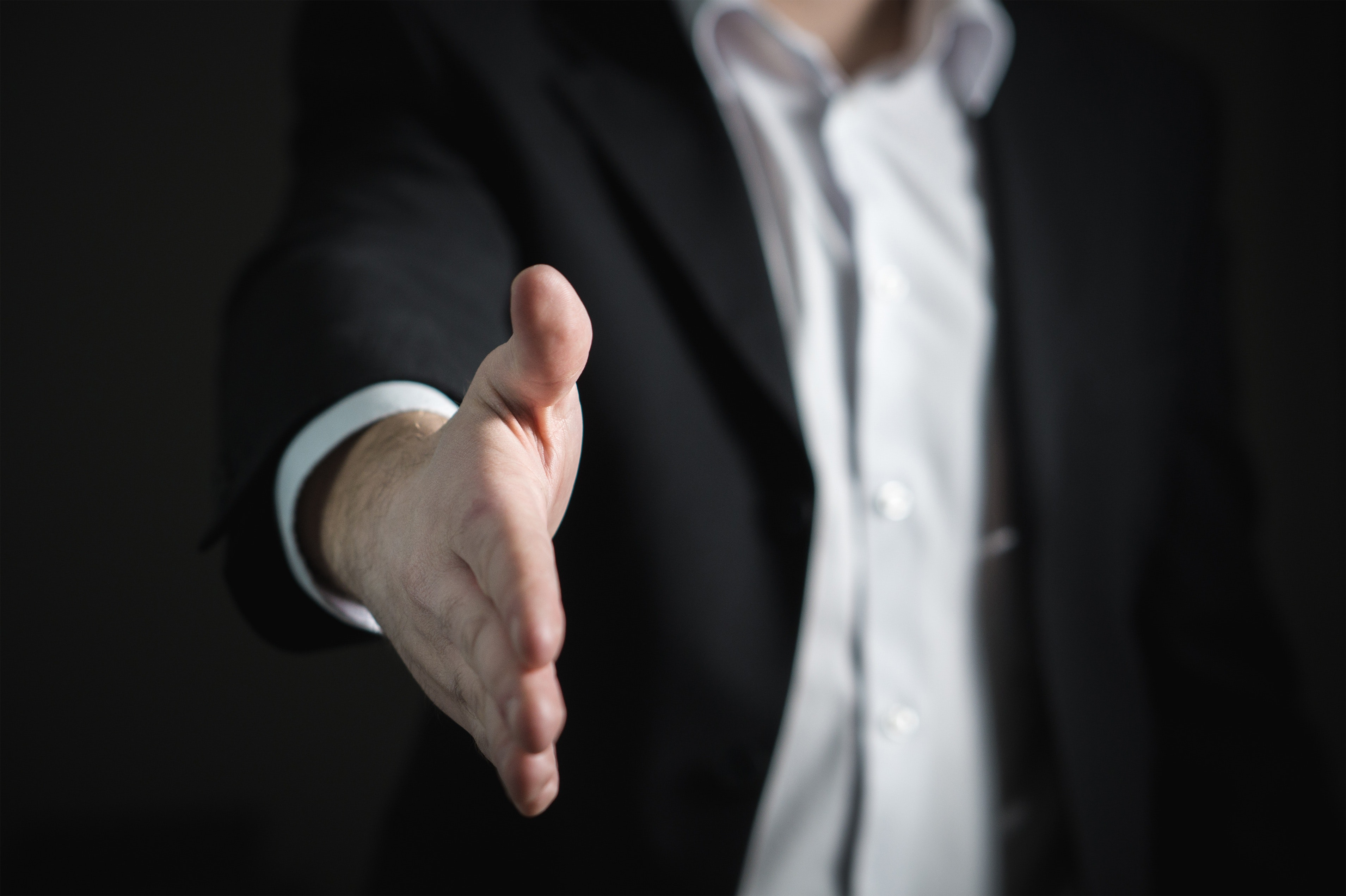 A man offering a hand, like at a job interview