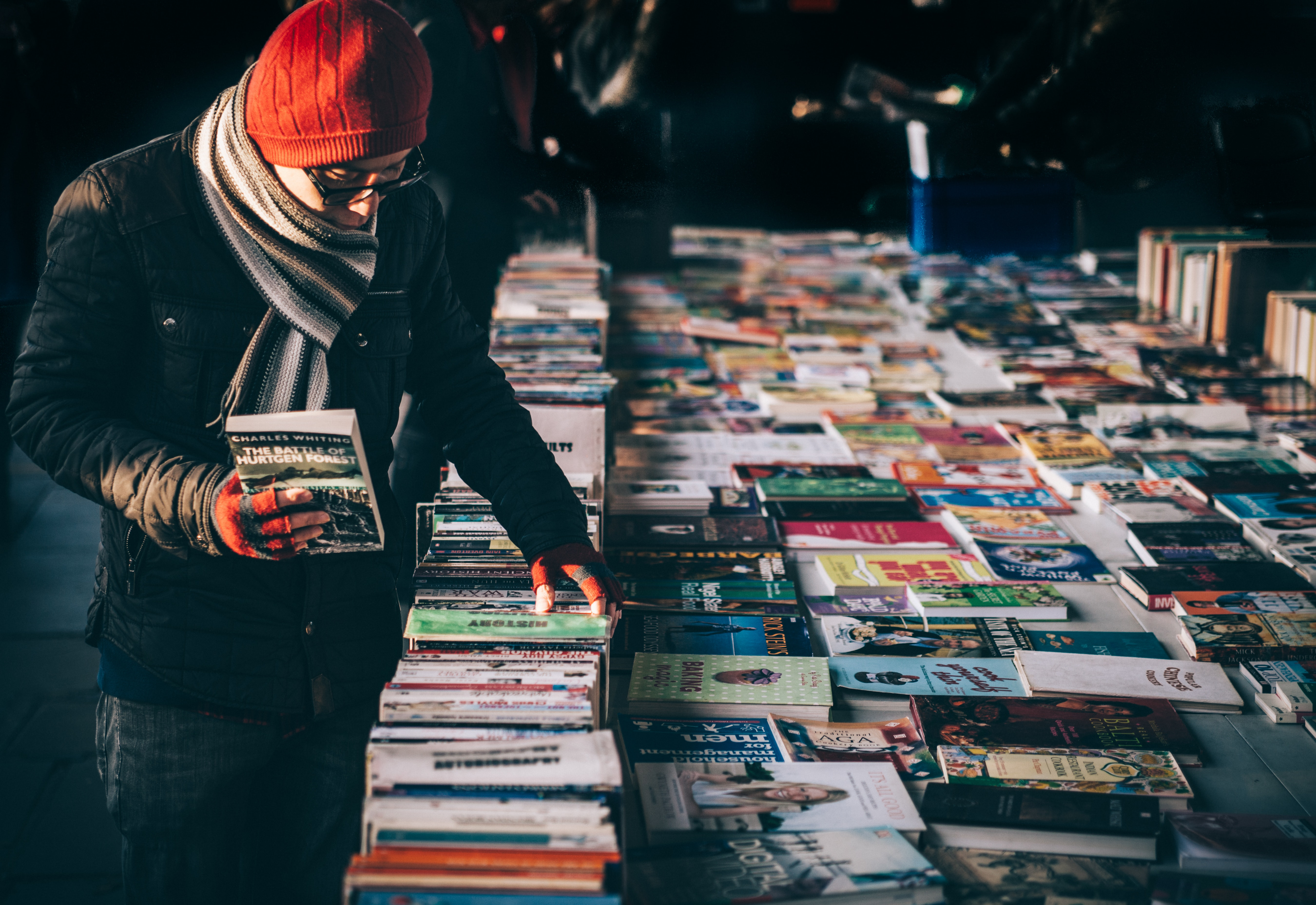 A man buying books at a yard sale.